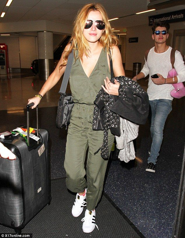 Coming home: Bella Thorne, 18, and boyfriend Gregg Sulkin, 23, returned from their Valenti...