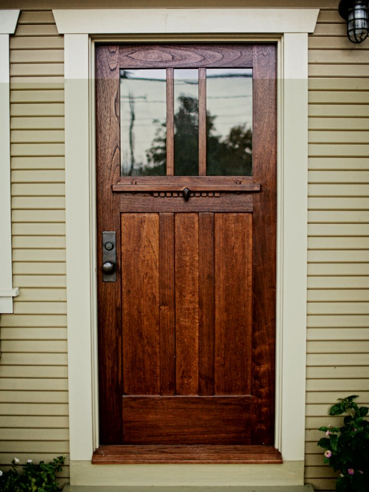 A craftsman style door of spanish cedar and antique glass for Back door styles