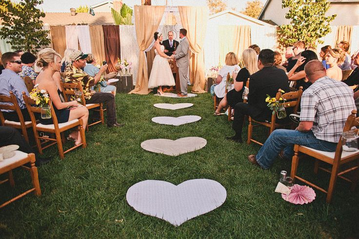 Burlap and lace altar. Lace covered hearts aisle. Vintage Rustic Wedding. Backyard wedding. DIY wedding. burlap and lace. Mark Brooke Photography
