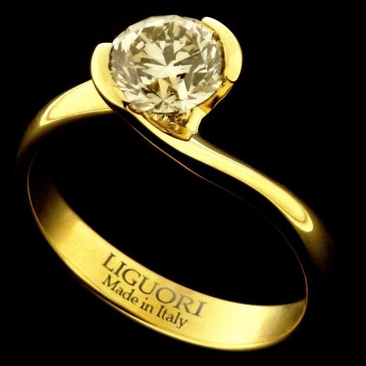 Solitario - LAG1487G  Anello solitario contrarie in oro giallo 18 kt. con dimante fancy light yellow.