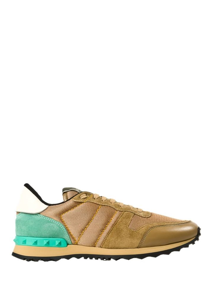 The leather sneakers from Valentino Garavani are the every season must have. In beige leather with light teal suede insert and studs, they look great with chino pants and an oversize sweater.