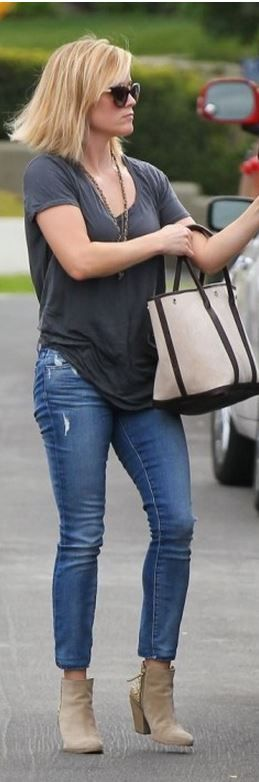 Who made  Reese Witherspoon's tan handbag, sunglasses, and blue skinny jeans?