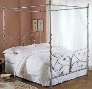"""A vibrant Chardonnay metallic matte finish completes the Evening Garden Iron Bed. The subtle, sophisticated silver palette provides the perfect compliment to the natural elements of this truly unique bed. Dimensions: Headboard Height: 52"""" Footboard Height: 34"""" Canopy Height: 82"""" Availability: Usually ships in 2-3 weeks. Evening Garden Canopy Beds & Metal Bed Frames in Queen Size GX031-01-03Regular Price: $2,497.50Sale Price: $1,665.00"""