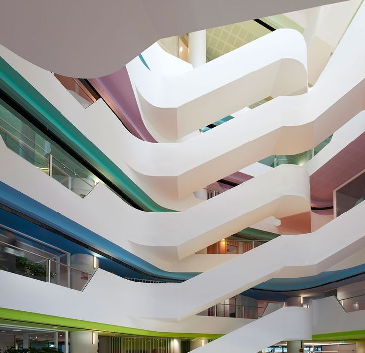 Hassell placed an atrium at the center of Medibank headquarters in Melbourne, Australia. Photography by Earl Carter/Taverne Agency.