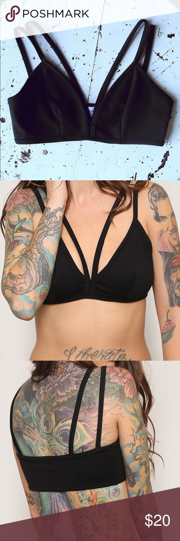 Phases Strappy Bralette This will really up your intimates game. Black & stretchy bralette, featuring a triangle cup with a V-neckline and a strappy front. Pair it with a mesh blouse and skinnies or under a low cut tee! Not adjustable. Gypsy Warrior Intimates & Sleepwear Bras