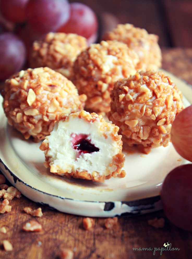 goat cheese truffles with red wine jelly filing rolled in crushed marcona almonds