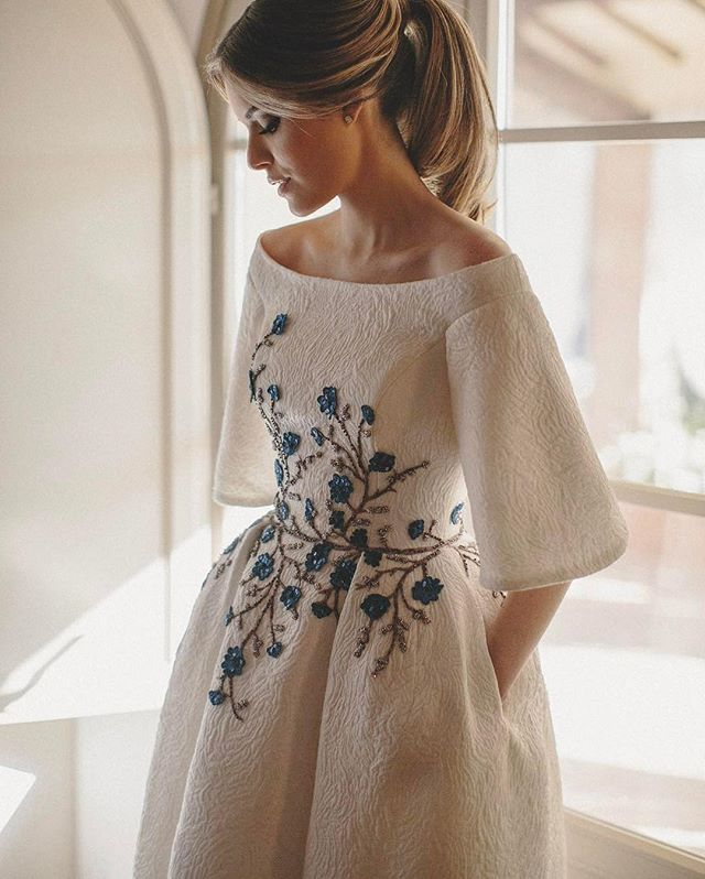 "The unique silhouette and embroidery featured on this custom @wanda_borges #weddingdress incorporate both a high fashion feel and the perfect hint of ""something blue."""
