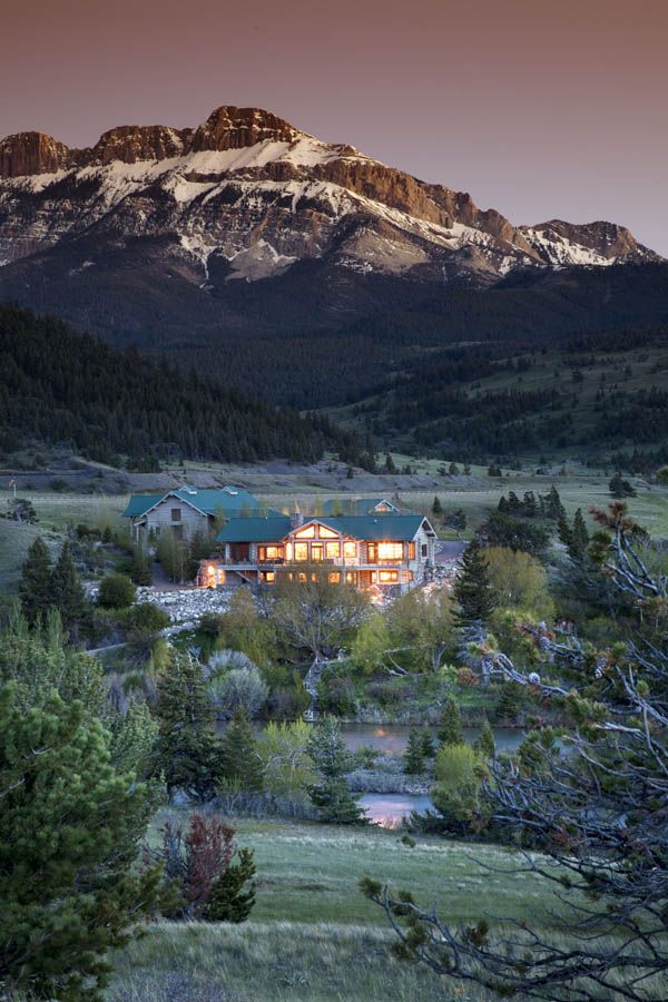 This Ranch home sits on 3000 acres spreading across both sides of the trout-rich Sun River just below the Gibson Reservoir Dam, in one of the most protected wildlife areas of Montana...guess the price tag...10,250,000.00 (not bad, hah).  It sure is beautiful though!