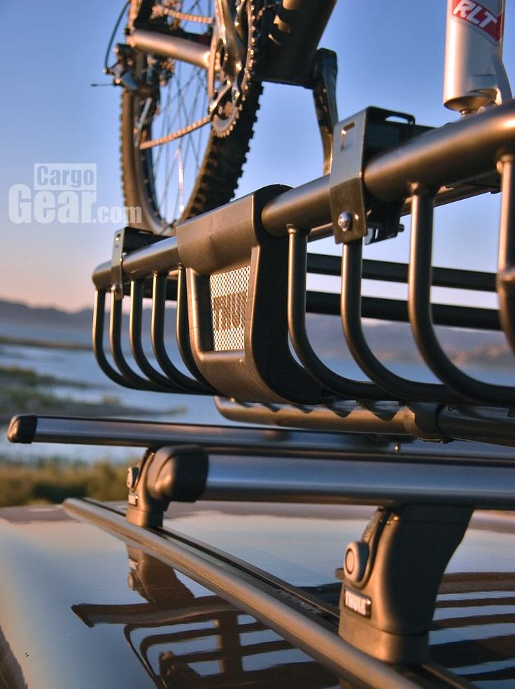Here you can see how the Thule Moab cargo basket mounts to your existing roof rack. It works with any Thule rack, as well as other brands and factory racks. The top of the M.O.A.B. basket has 2 of its own crossbars, so you don't lose any carrying capacity. These bars can be used to mount kayak racks, bike mounts (shown here), and other accessories. The M.O.A.B.'s load bars are standard Thule square bars.