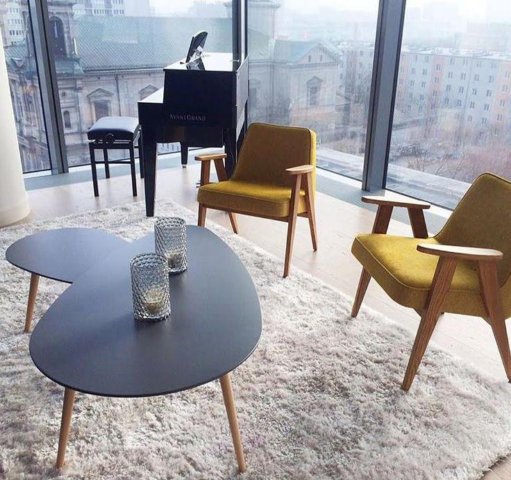 366 easy chairs in Apartament Cosmpolitan in Warsaw / LOFT Mustard