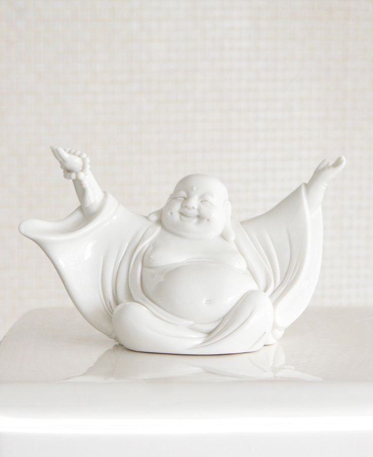 White porcelain statue of portable size depicts the Happy Buddha in artistic detail with his arms outspread in a gesture of joy and celebration.