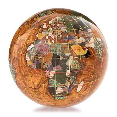 Gemstone Paperweight Copper Amber (Free Shipping) Gemstone globe is handmade with a variety of semi precious stones that are individually hand carved to represent each country. Each gemstone globe paperweight features 25 semi precious stones selected from countries around the world and, where possible, show the country of origin. Longitude, latitude and international date lines are added with a fine gold or silver thread.