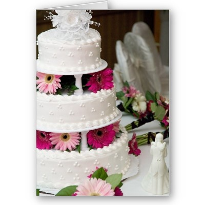 wedding cake with gerbera daisies