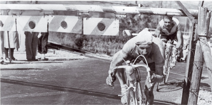 ......Gino Bartali elegantly risking head and life at a railroad crossing!