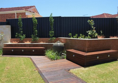 Residential Landscape Gallery - Perth, Western Australia - Built by DBM Landscapes. Raised garden beds, water feature, garden lighting and merbau timber. www.dbmlandscapes.com.au