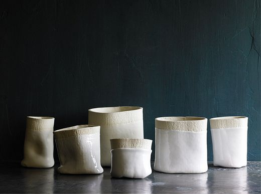 Elephant ceramics cups/vases- love the contrast of glaze/ un glazed, shiny and smooth,vs  matte and rough