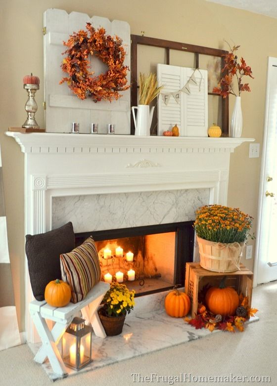 Decorate your fireplace mantel with fall home decor in warm colors like orange and brown. #pumpkins #falldecor #homedesign