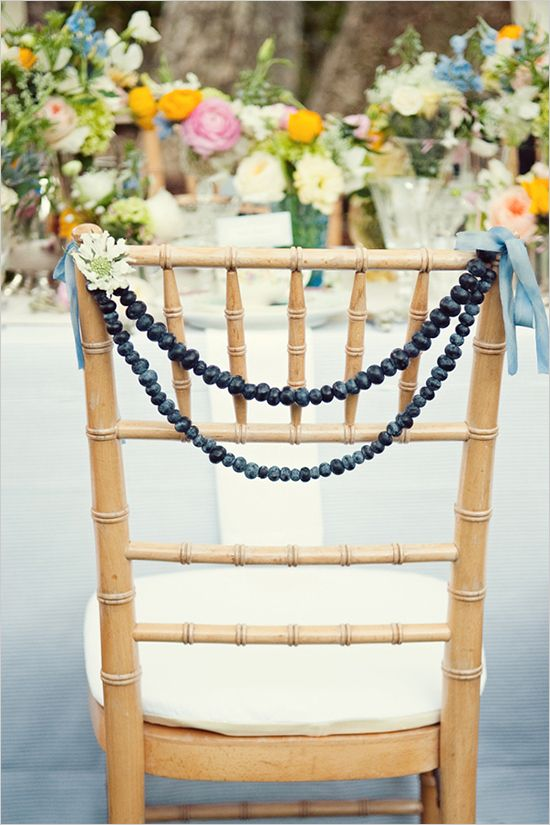 Blueberry strands for chair decor. Be sure to check out the rest of this Blue + Vintage + Blueberry Wedding Styled Shoot.