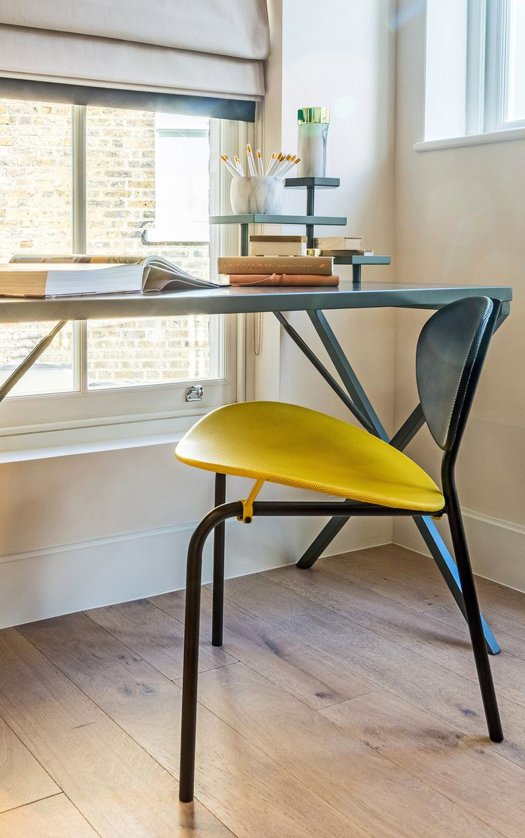 Abundant in natural light, we contrasted the organic feel of the exposed wooden flooring with stylish lacquered metal, adding a bright pop of colour and modern charisma with this bold black and yellow chair.