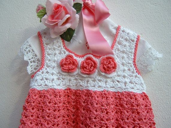 Hand crocheted baby dress in pink and white cotton. Crochet