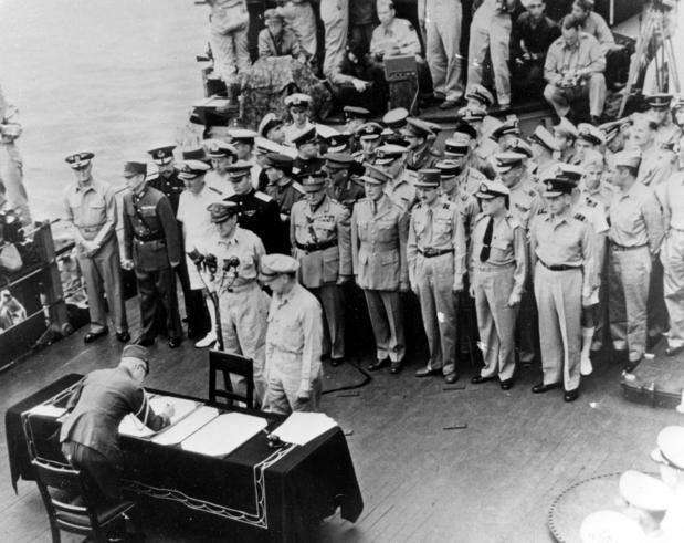 General of the Army Douglas MacArthur, on behalf of the Allied Powers, accepts the surrender of the Empire of Japan, formally ending World War II.
