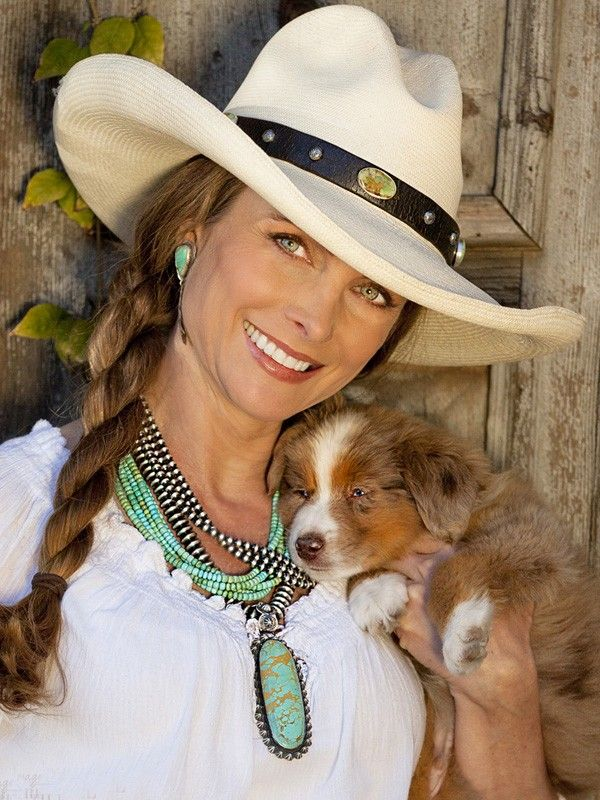 ~ Brit West shows how to wear a western hat complete with beautiful leather hatband.  Aside from her lovely turquoise jewelry, the only other embellishment in this photo is Happy, her dog...sound asleep on mommy's shoulder. ~