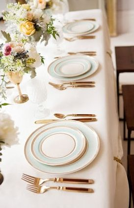 classic table setting with blue trimmed china