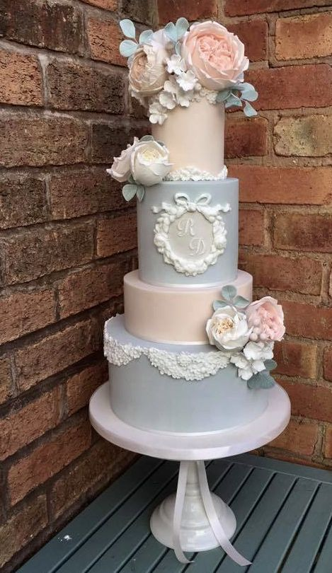 Romantic four tier blue and blush wedding cake with white lace cake detail; Featured Cake: Cotton and Crumbs