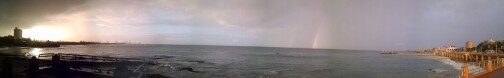 Port Elizabeth, South Africa. Captured in panorama as a storm left on the Eastern end of the beachfront. Plus double rainbow if you look carefully.