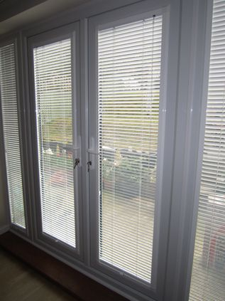Perfect Fit Wood Venetian ' Innovation Blinds. Love the way they fit over just the glazing on the doors.