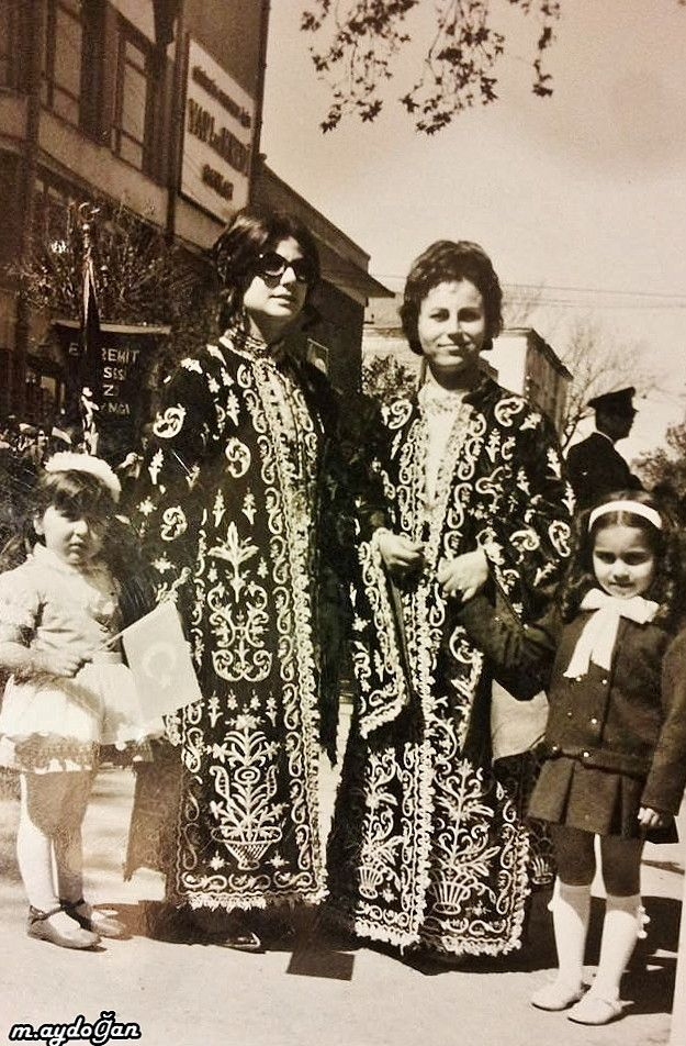 Two townswomen from Edremit (in the West of the Balıkesir province), wearing traditional embroidered 'üçetek' (robe-with-three-panels).  23 Nisan (April 23th) 1971, on Children's Festival Day.