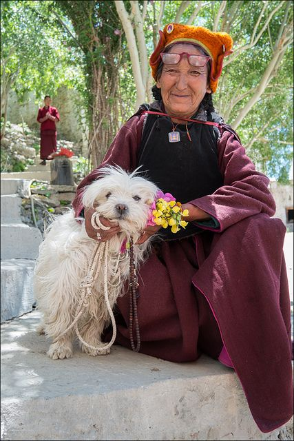 An older woman in Kashmir, India with her adorable beloved pup.