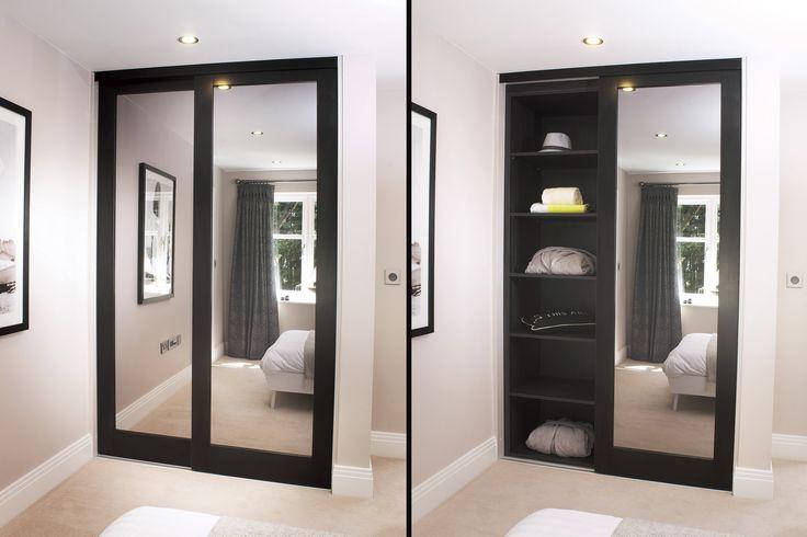 Aspen sliding wardrobe doors shown in dark walnut finish with a mirrored glass infill