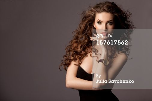 Title: Beautiful woman with watches Creative image #: 157617562 License type: Royalty-free Photographer: Julia Savchenko Collection: E+ Credit: Julia Savchenko Release information:This image has a signed model and property release. This image is available for commercial use. Copyright: Julia Savchenko