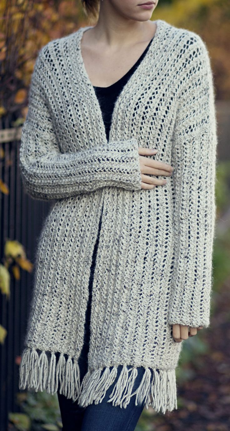Free Limited Time Only - Knitting Pattern for 2 Row Repeat Lace Rib Cardigan. Free for a Limited Time – No End Date Listed.Long sleeved sweater in a 2 row repeat lace pattern in Aran weight yarn. Designed by Katrine Hammer.