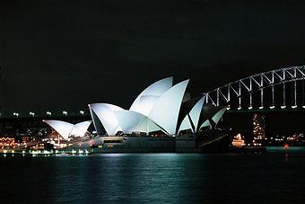 Night view of the Opera House (UNESCO World Heritage List, 2007), 1973, architect Jorn Utzon, and Harbour Bridge, 1923-1932, Sydney, New South Wales. Australia, 20th century.