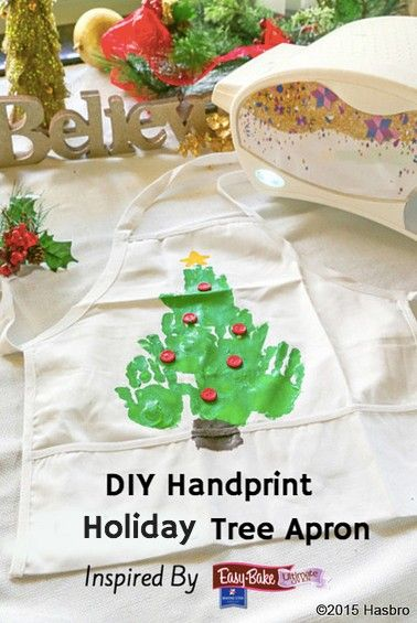 What better way to use your Easy-Bake Ultimate Oven than in this holiday tree apron made from your children's handprints! #ad