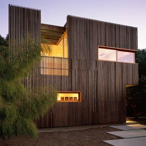 Coldwater Studio by Casey Hughes Architects | A recessed balcony carves a rectangular hole in the facade of a writer's house in north Hollywood. Narrow batons of red cedar clad the two-storey house.