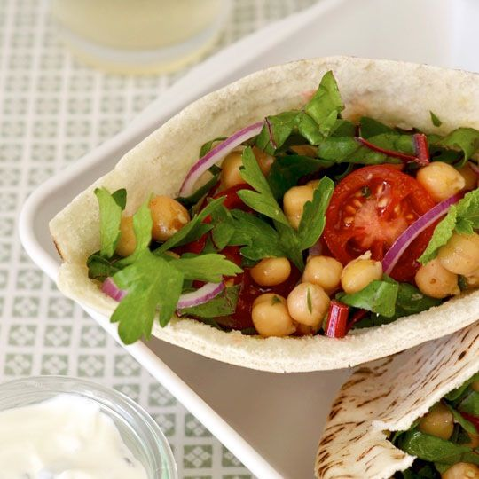 """Even though I work from home about ten steps away from the kitchen, I have a terrible habit of not breaking for food. Fortunately I've gotten a bit better since setting pop-up alerts on my computer (""""eat breakfast!"""" """"lunch time!"""") and planning for meals like these vegetarian chickpea pitas. They're refreshing, filling, best made ahead of time, and easy to eat. No excuses!"""