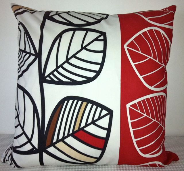 modern leafy red, white, and black cushion cover. don't mind these to re-do my family room lounge backing cushions
