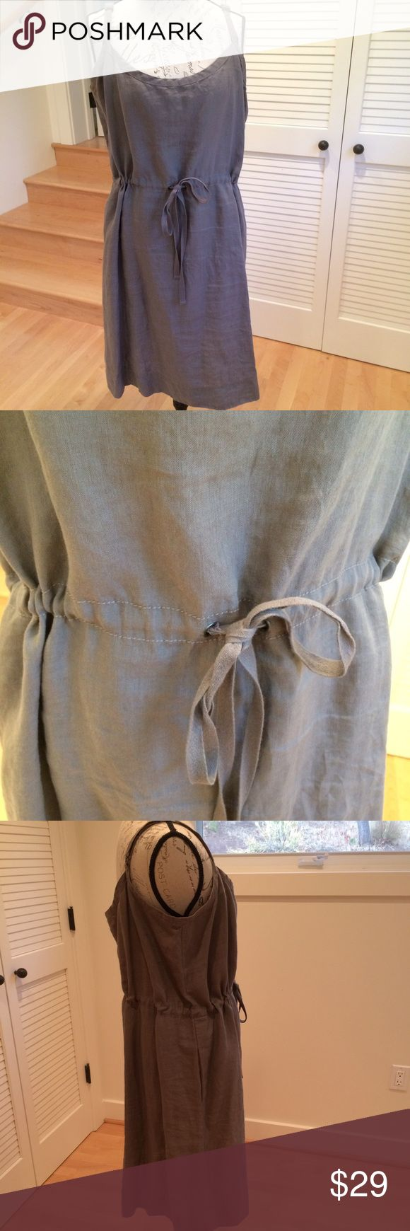 Eileen Fisher short linen dress with straps Eileen Fisher short linen dress with straps, taupe color. Straps are adjustable. Dress also has an internal belt adjustable according to the waist size. Extremely comfortable. XL but fine for L too. Gently worn. Eileen Fisher Dresses