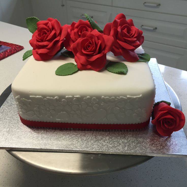 Handmade red fondant roses and floral stencilling
