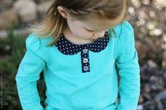 Add a Peter Pan collar with buttons to a t shirt. Tutorial from Make It Love It.