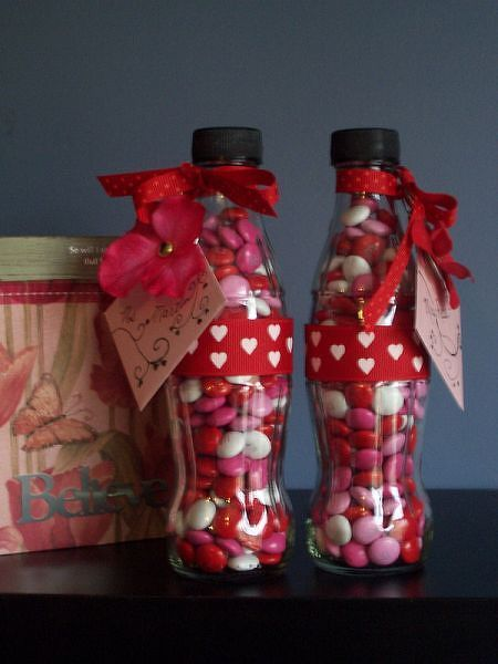 """This is shown for valentines, but could be done for almost any occassion, or none at all. Also, since Hershey offers many of their candies in """"pieces"""" form you have a lot of color choice. The hardest part would be cleaning the empty soda bottles."""