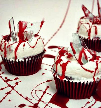 """Dexter #Cupcake -  This #redvelvetcupcake has caramel """"blood"""" spattered on vanilla icing. To make things seem more real, the cupcake is topped with """"glass shards"""" made of sugar. #dexter"""