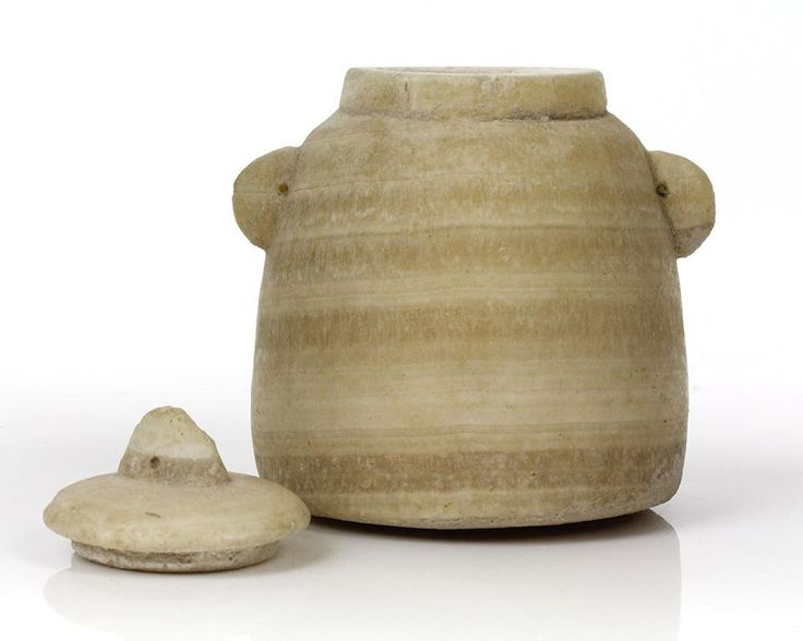 """A Biblical """"Beehive"""" Unguent Jar and Lid, Hellenistic Period, ca. 3rd-1st Century BC"""