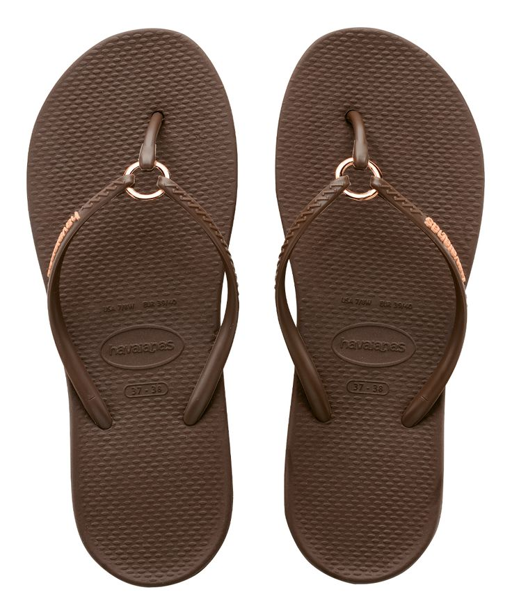 A shimmering metallic ring adorns these classic flip-flops with pedicure-worthy style. Contrast logoMetallic ring detail at toe postCushioned footbed with textured rice patternSynthetic upperRubber soleImported