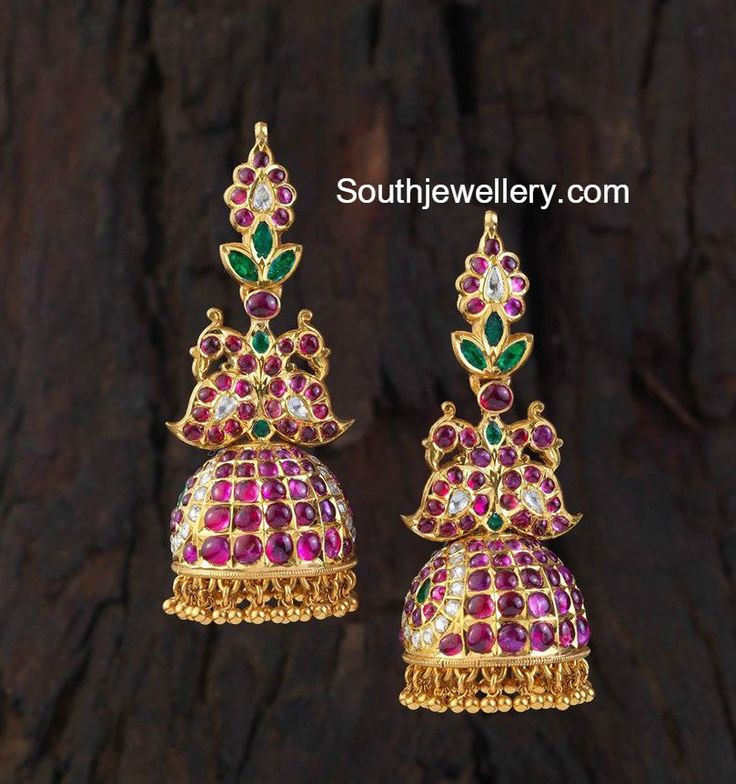 22 carat gold beautiful antique peacock jhumkas studded with rubies, emeralds and kundans by Creations Jewellery. For inquiries contact:+91 99020 69225 Related Posts35 Grams Antique Gold JhumkasRakul Preet in Antique Peacock JhumkasRuby JhumkisPeacock Kundan JhumkasAntique Gold JhumkasAntique Kundan Jhumkas
