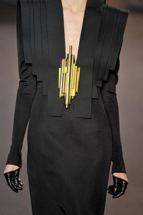 Art Deco-inspired gown with gold detail and finger gloves.