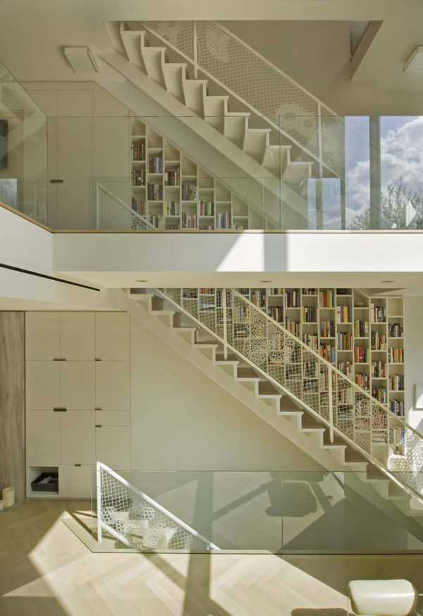 bookshelves lining the stairway! Propect Place - Tina Manis